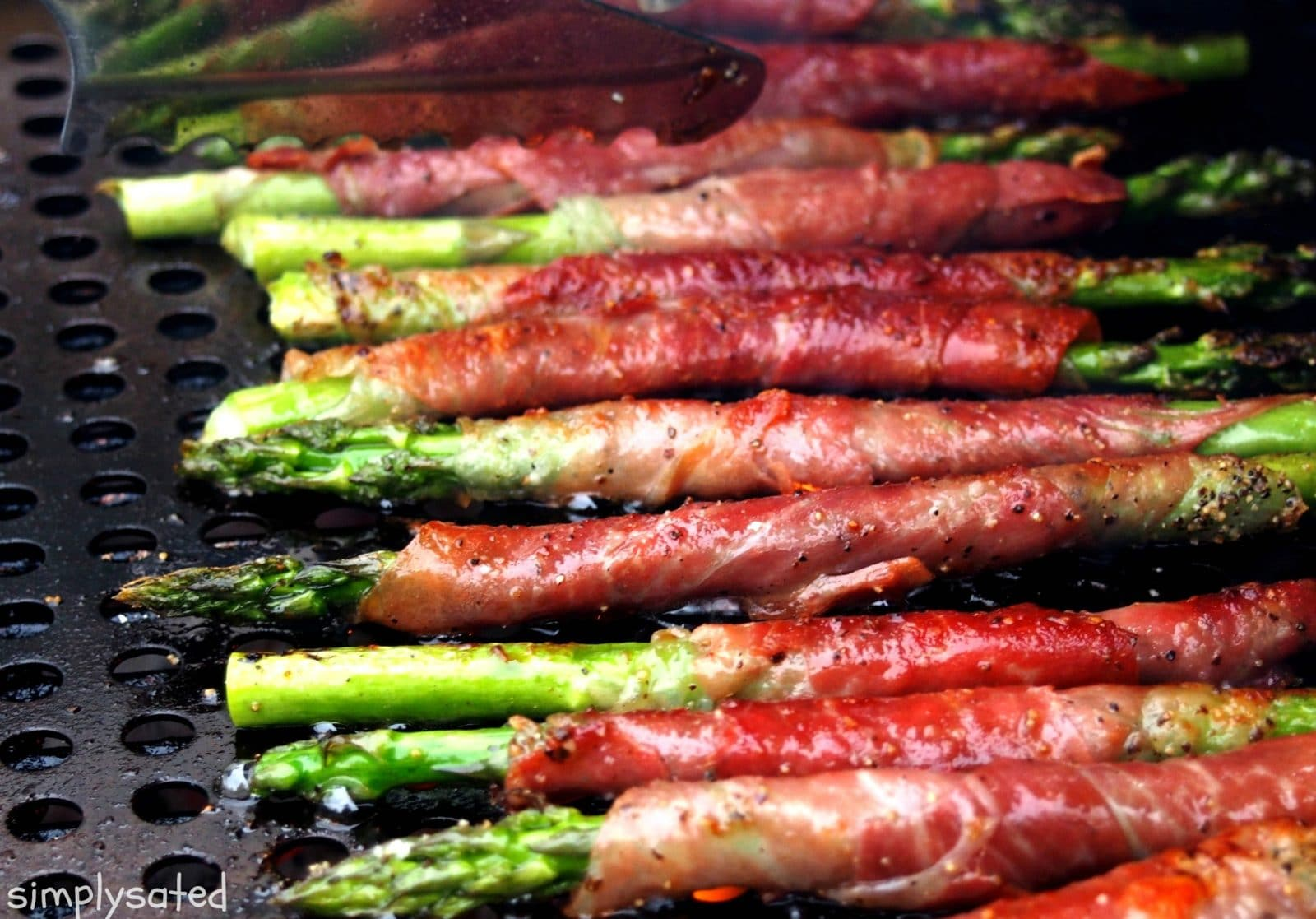 Grilled Asparagus with Prosciutto - simple & scrumptious. Fresh asparagus wrapped with prosciutto then grilled to perfection.