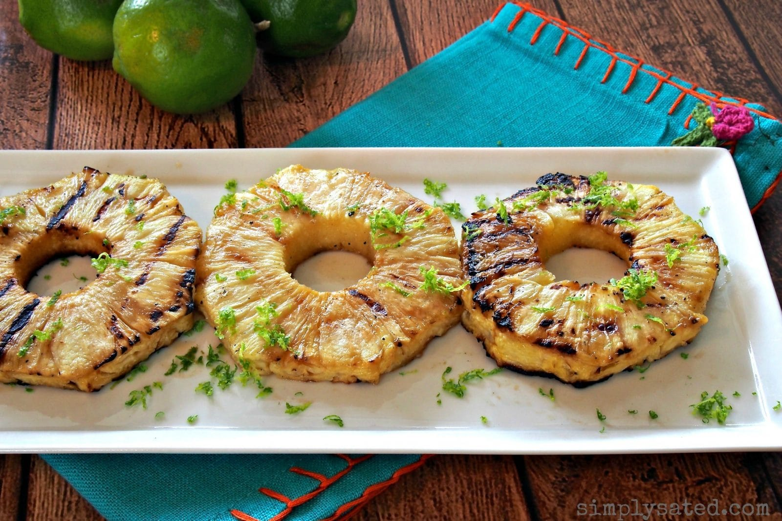 Grilled Pineapple with Lime Zest is a terrific side dish or dessert. Simple, beautiful and delicious. A great combo. www.simplysated.com