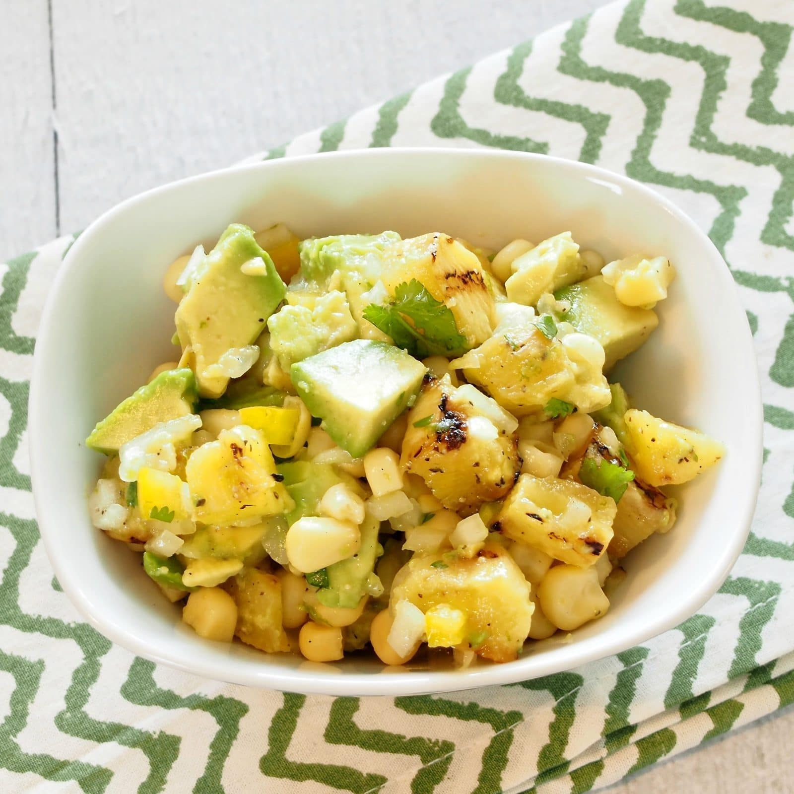 Grilled PIneapple, Avocado & Corn Salad is delicious served as a salad or salsa. The perfect pairing of flavors and so beautiful. www.simplysated.com