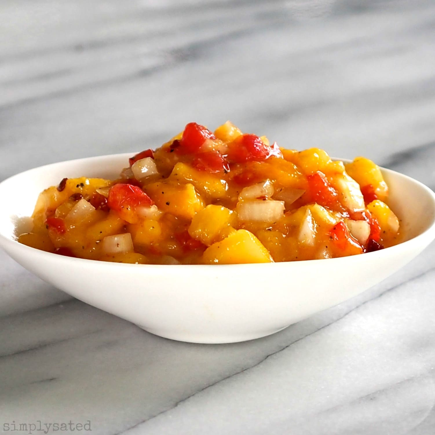 Molasses Dipped Chicken with Mango Salsa makes you feel like dancing. Chicken dipped in molasses, spiced-up and cooked. Top with sweet & spicy Mango Salsa.