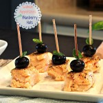 Salmon Appetizers with Blueberry Hats are beautifully simple. Baked salmon bites topped with a blueberry and basil.