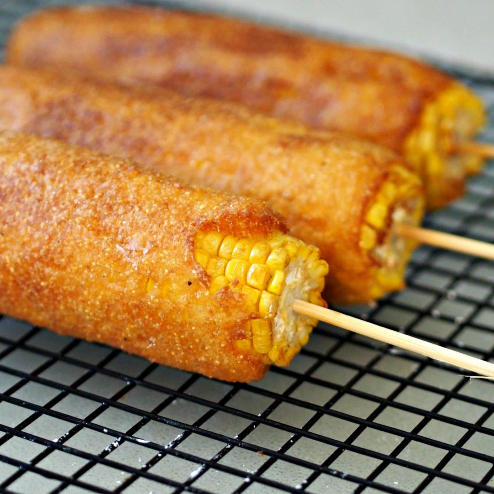 Batter Fried Corn-on-the-Cob is the marriage of the corn dog and corn-on-the-cob and is surprisingly delicious. www.simplysated.com