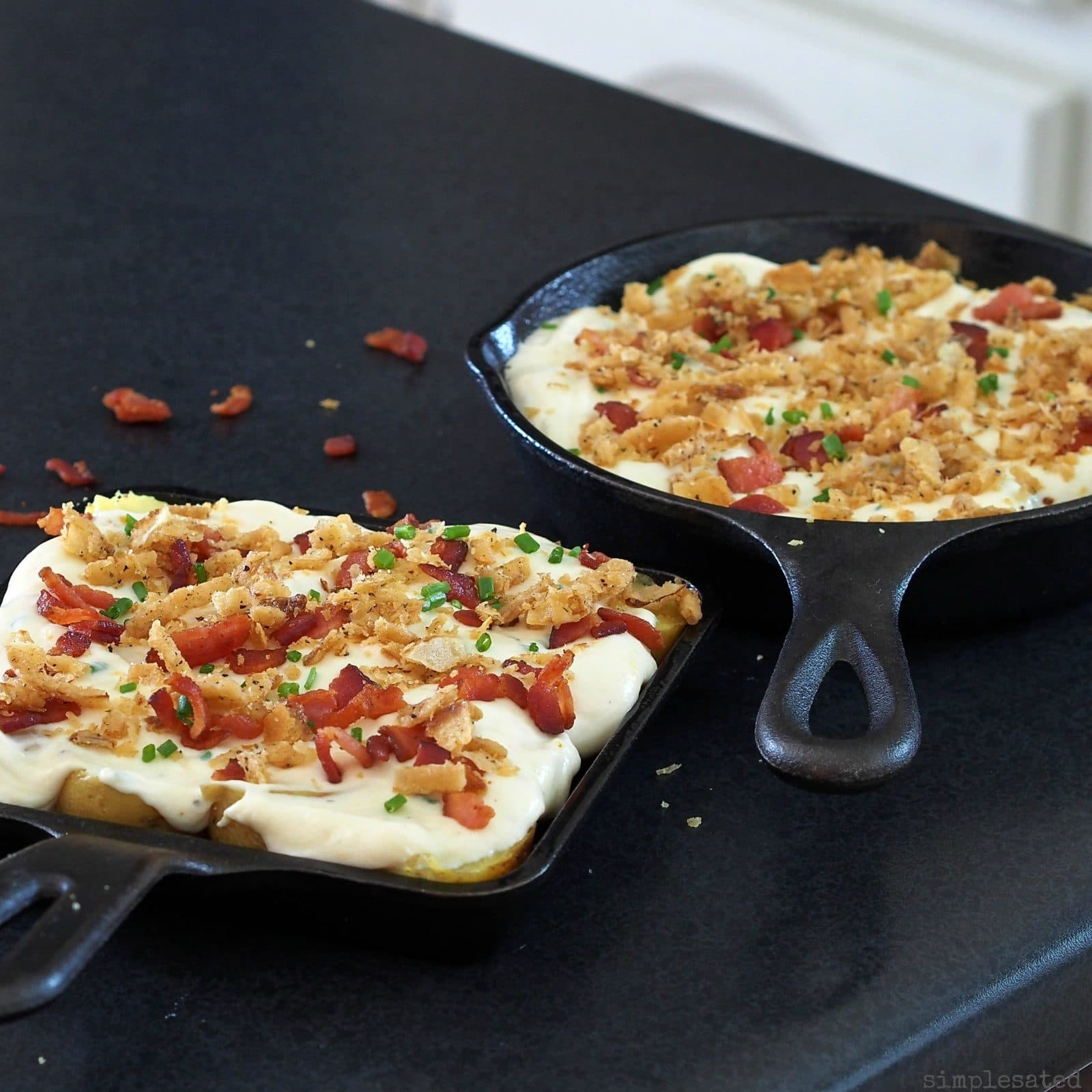 Loaded New Potato Casserole - roasted new potatoes combined with cheese, chives, sour cream and bacon. Serve as a side or a beautiful appetizer.