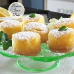 Luscious Lemon Bars - the perfect lemony sweet/tart custard on a shortbread crust. A great traditional dessert. www.simplysated.com