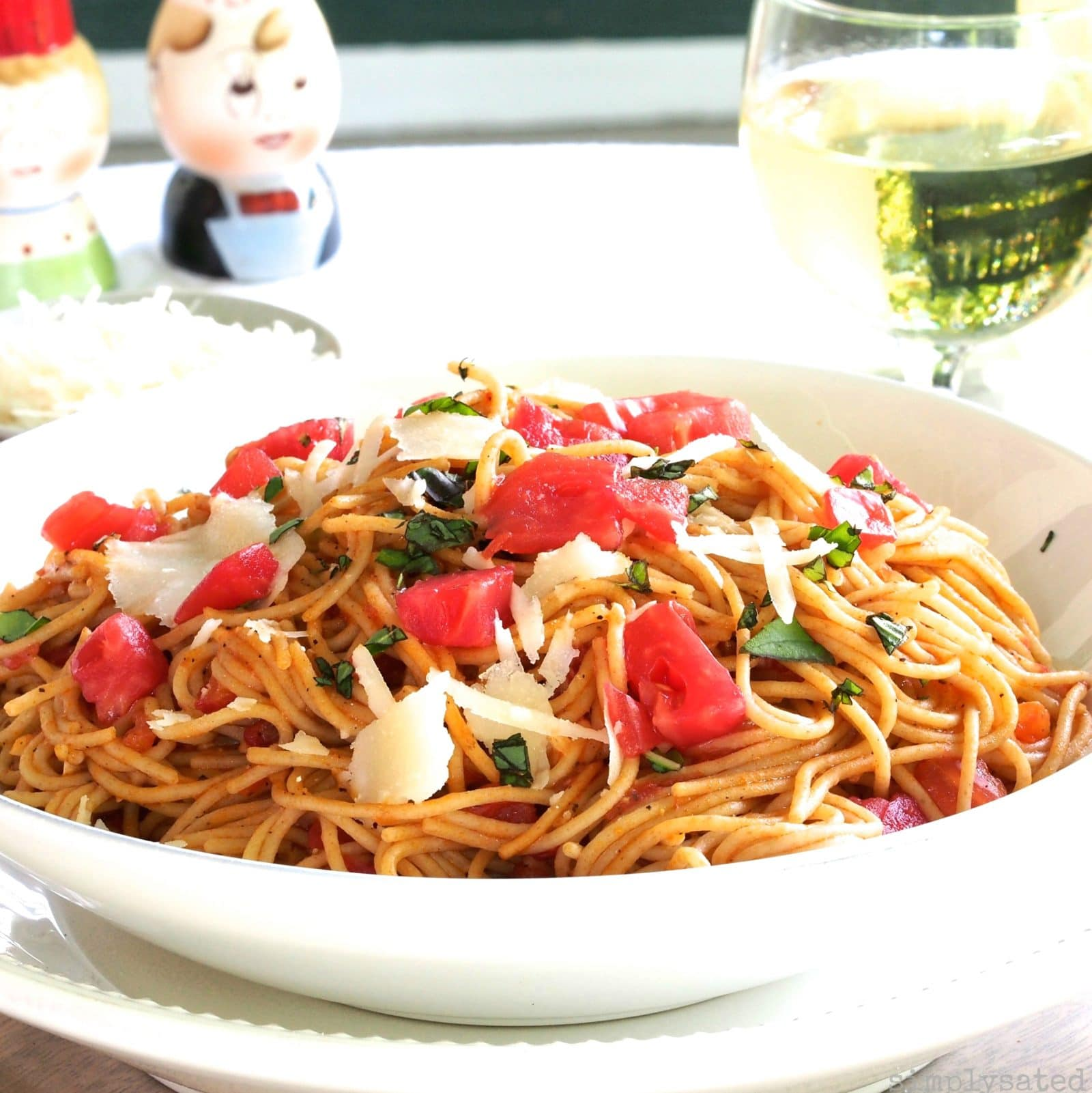 Spaghetti Pomodoro is delicious in its simplicity. Spaghetti, tomatoes, garlic, olive oil, basil and parmesan. simply sated