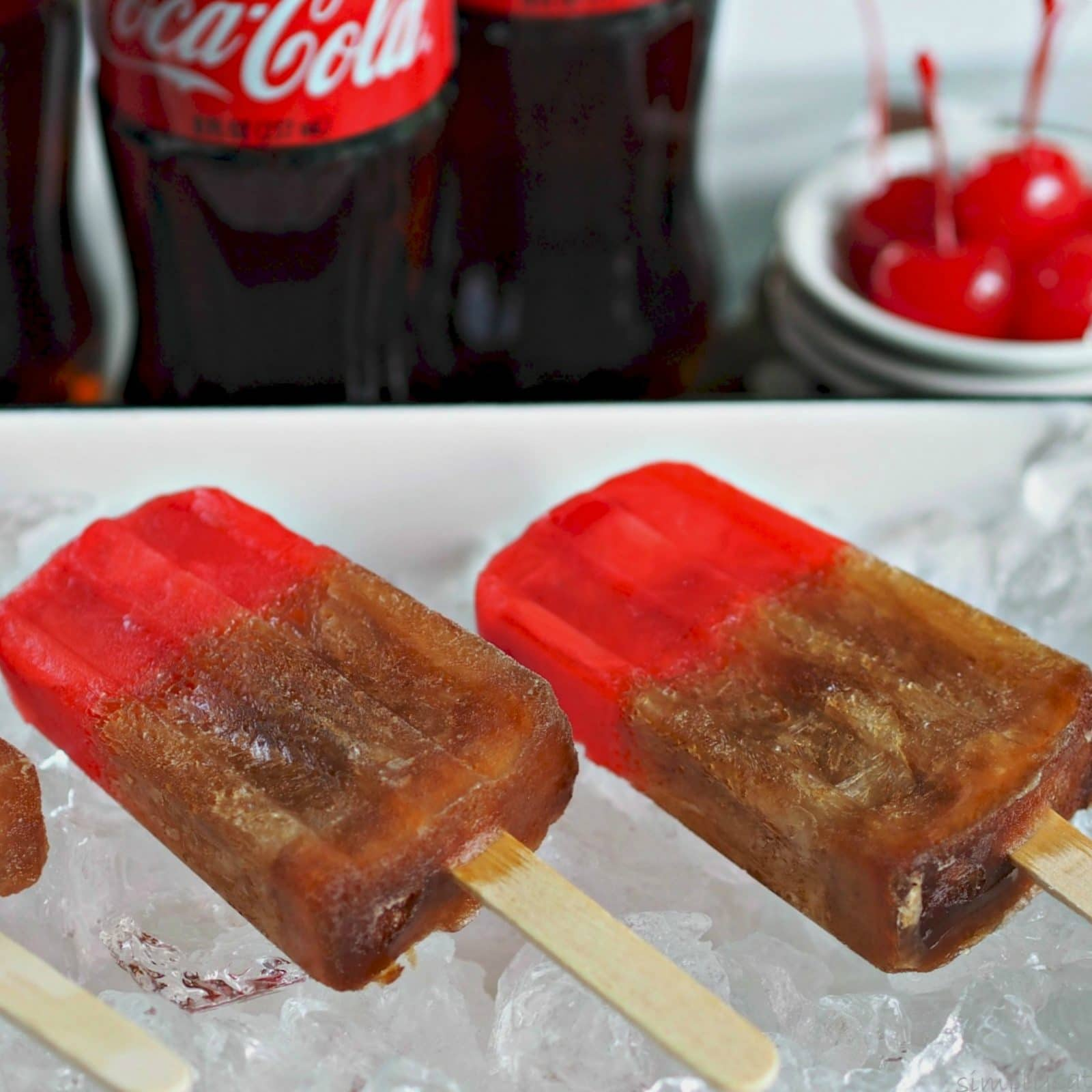 Cherry Coke Popsicles are a fun take on the real thing. www.simplysated.com