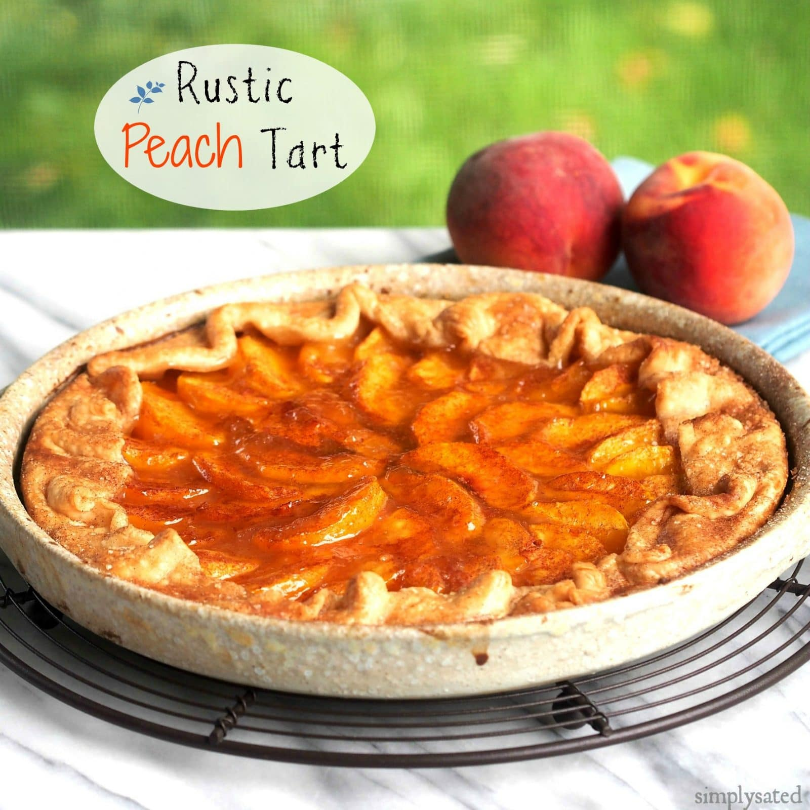 Rustic Peach Tart is easy, beautiful and delicious. Fresh peaches, store-bought crust and a few simple ingredients come together to make a great dessert. Simply Sated