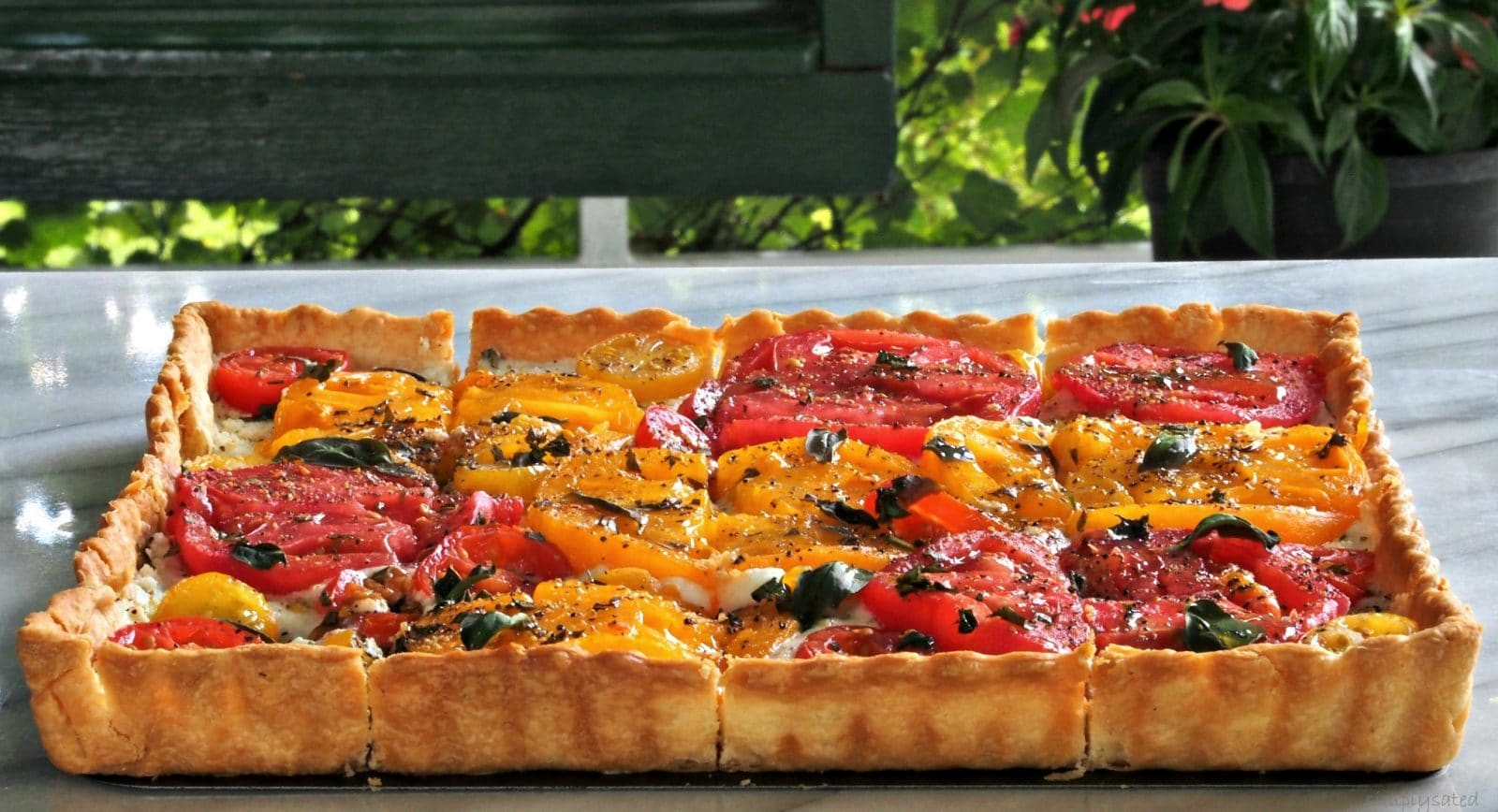 Tomato Tart with Mascarpone & Basil - pie crust layered with mascarpone, & basil then topped with fresh tomaotes. simply sated