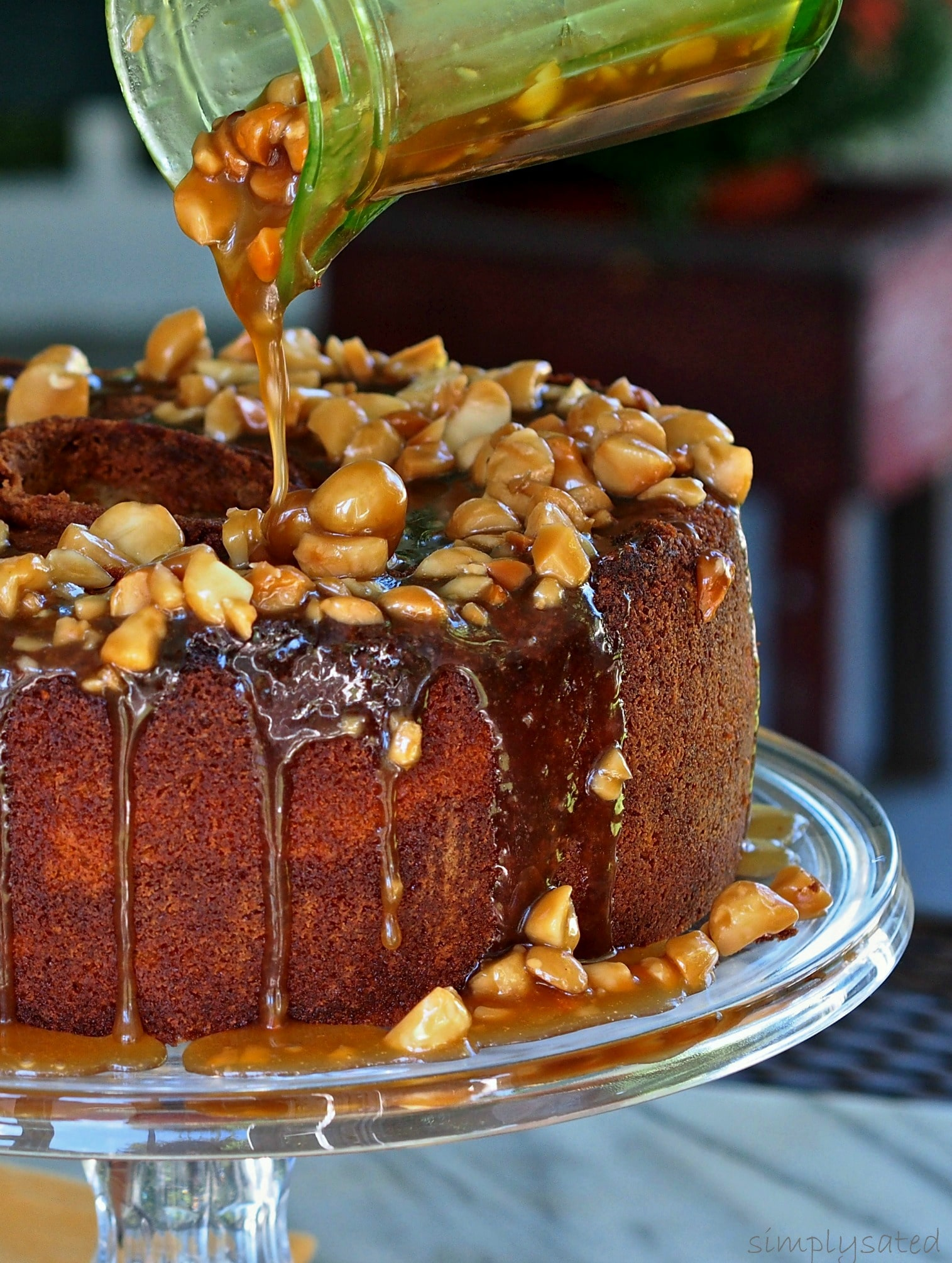 Caramel Macadamia Pound Cake - Brown sugar pound cake topped with caramel and toasted macadamia sauce - lick-the-plate. simplysated.com