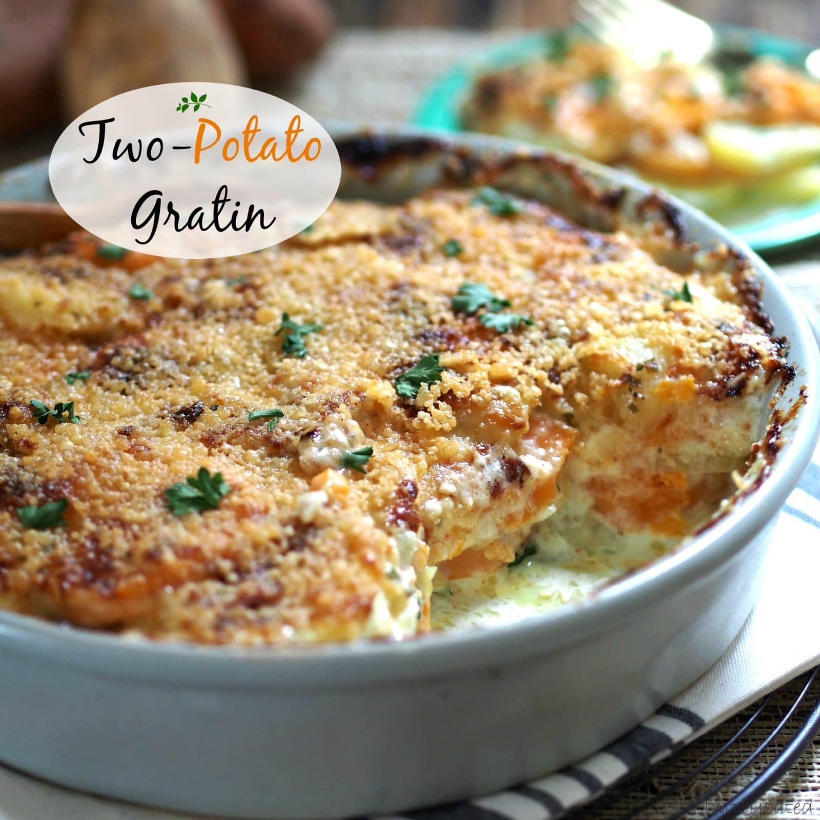 Two-Potato Gratin - Sweet potatoes, Yukon Golds & Gruyere cheese come together to create this delectable dish. Simply Sated