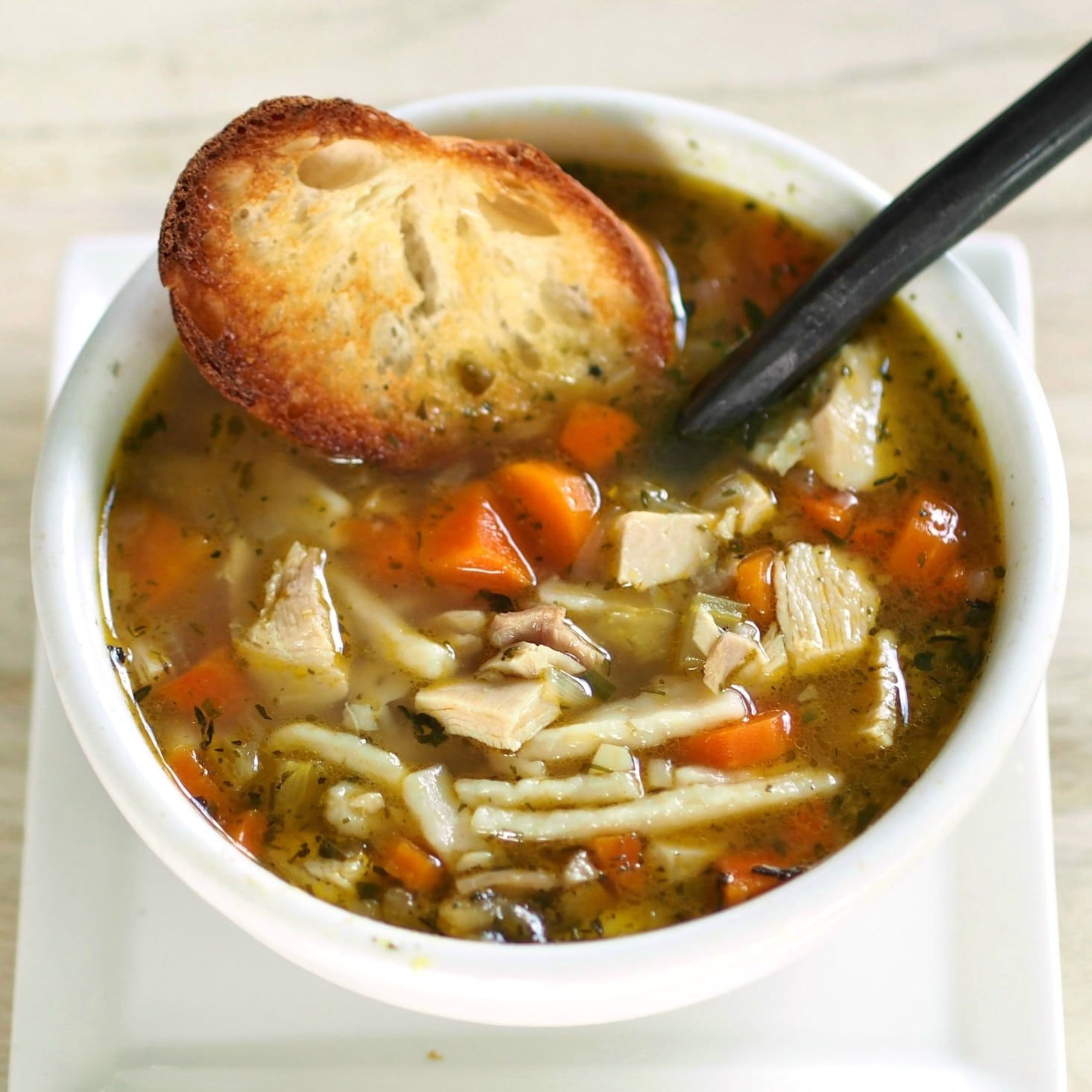 "Chicken Noodle Soup is known to cure what ails you. No ""spoonful of sugar"" needed to help this soup go down. Simply Sated"