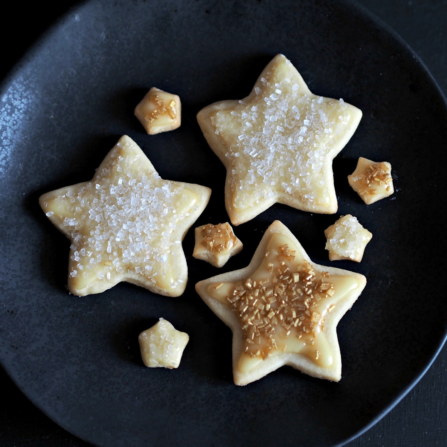 Gold Star Iced Cookies are a cookie deserving of a gold star. Tender inside & slightly crispy outside. Topped w/a simple corn syrup glaze & sanding sugar. Simply Sated