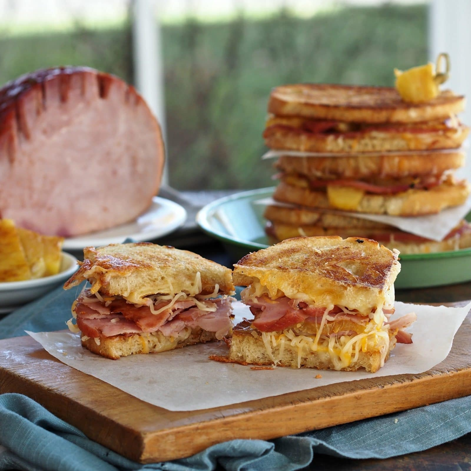 Pepper Jelly Hawaiian Grilled Cheese-toasted buttery bread, Gruyere & Mexican cheeses, caramelized fresh pineapple & Jones Dairy Ham with hot pepper jelly. Simply Sated