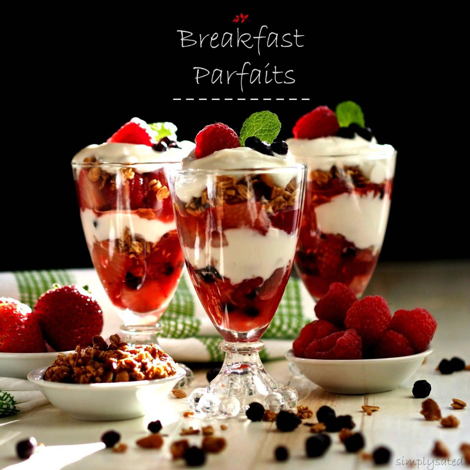 Breakfast Parfaits aren't only beautiful, they are healthy, nutritious & delicious. Strawberries, raspberries, Greek yogurt and crunchy homemade granola.