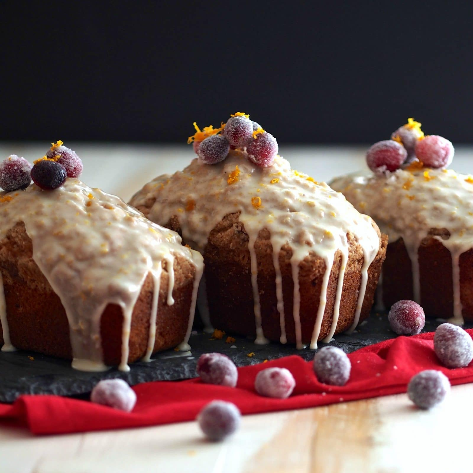 Orange-Glazed Cranberry Bread has the perfect blend of flavors: citrus from the orange, tartness from cranberries & a little hint of spice. Perfect. Simply Sated