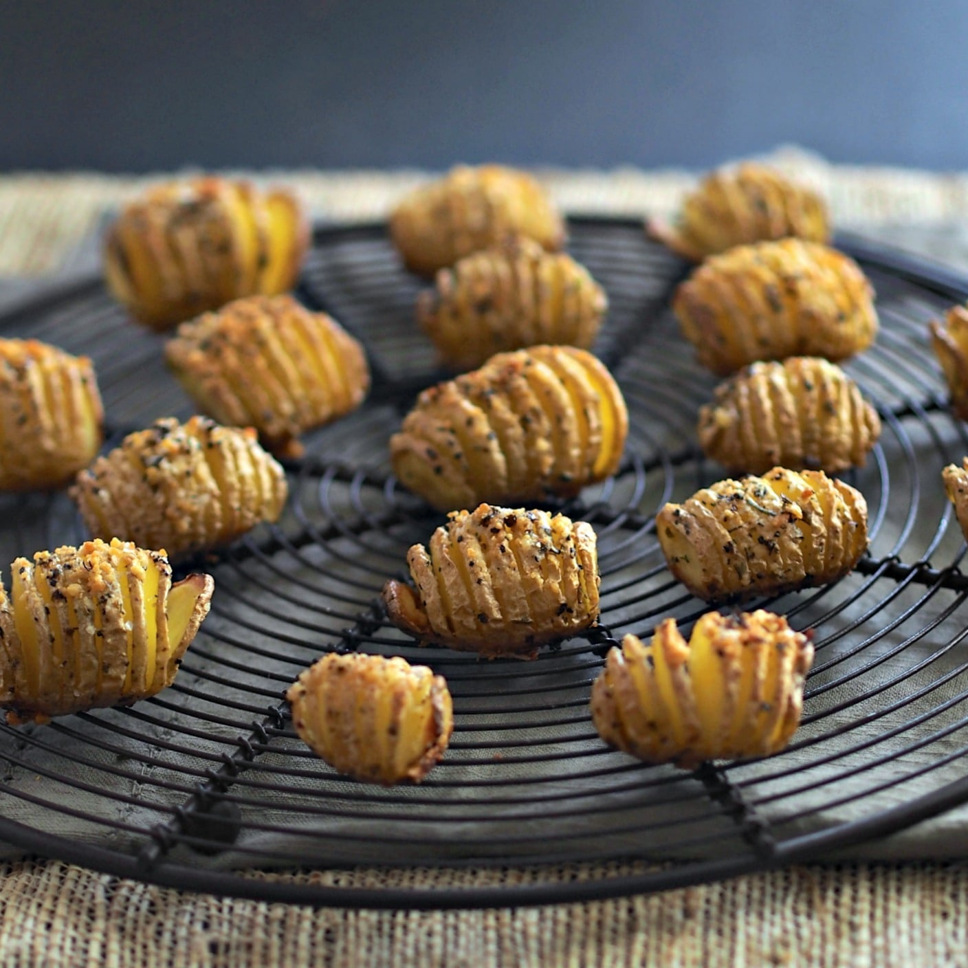 Baby Hasselback Potatoes - the perfect side for a family meal or formal dinner party. Accordion-sliced baby gold potatoes fan open while baking. Simply Sated
