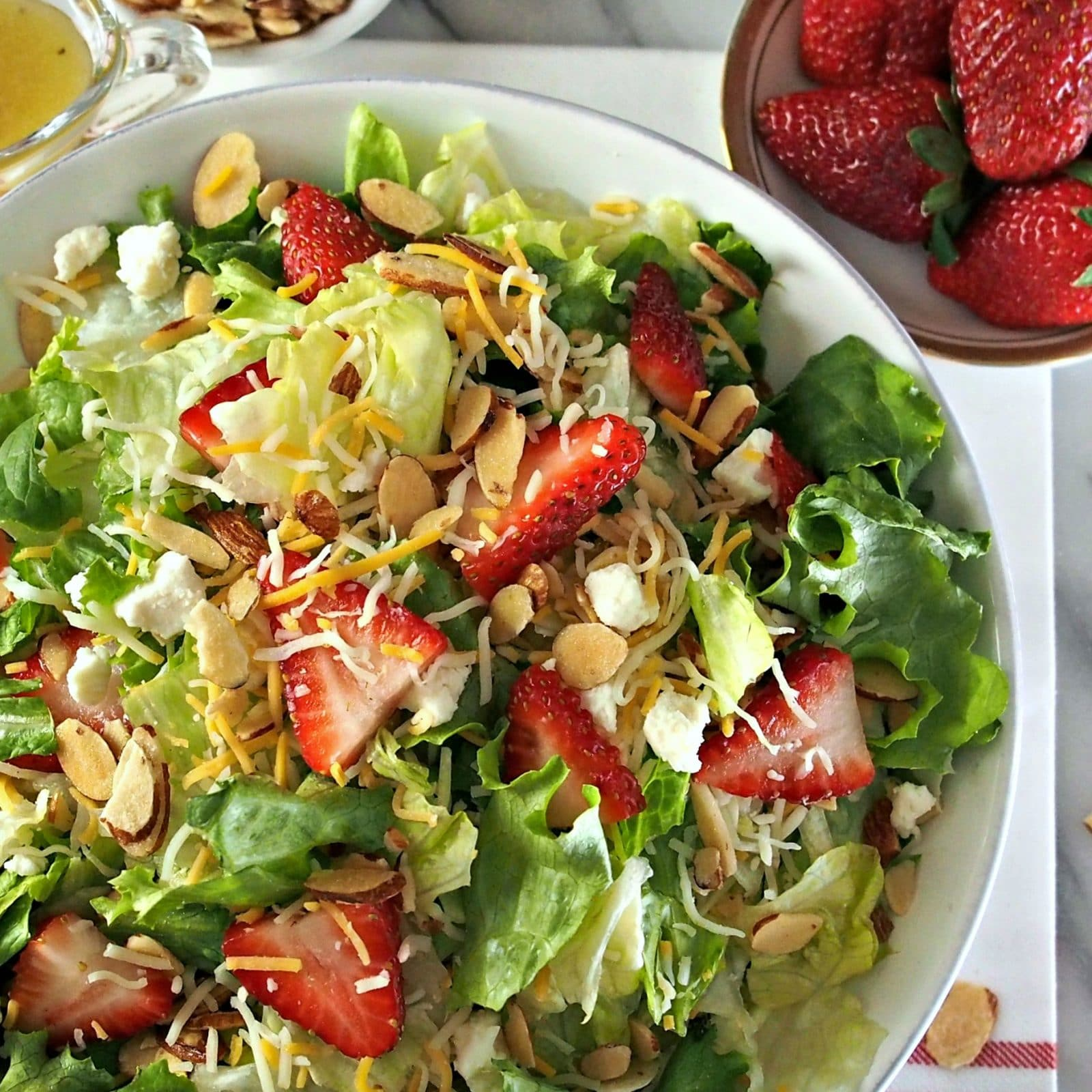 Strawberries & Greens Salad has stood the test of time. Strawberries, greens, sugared almonds, cheese with poppy seed sweet & sour dressing & croutons. Simply Sated