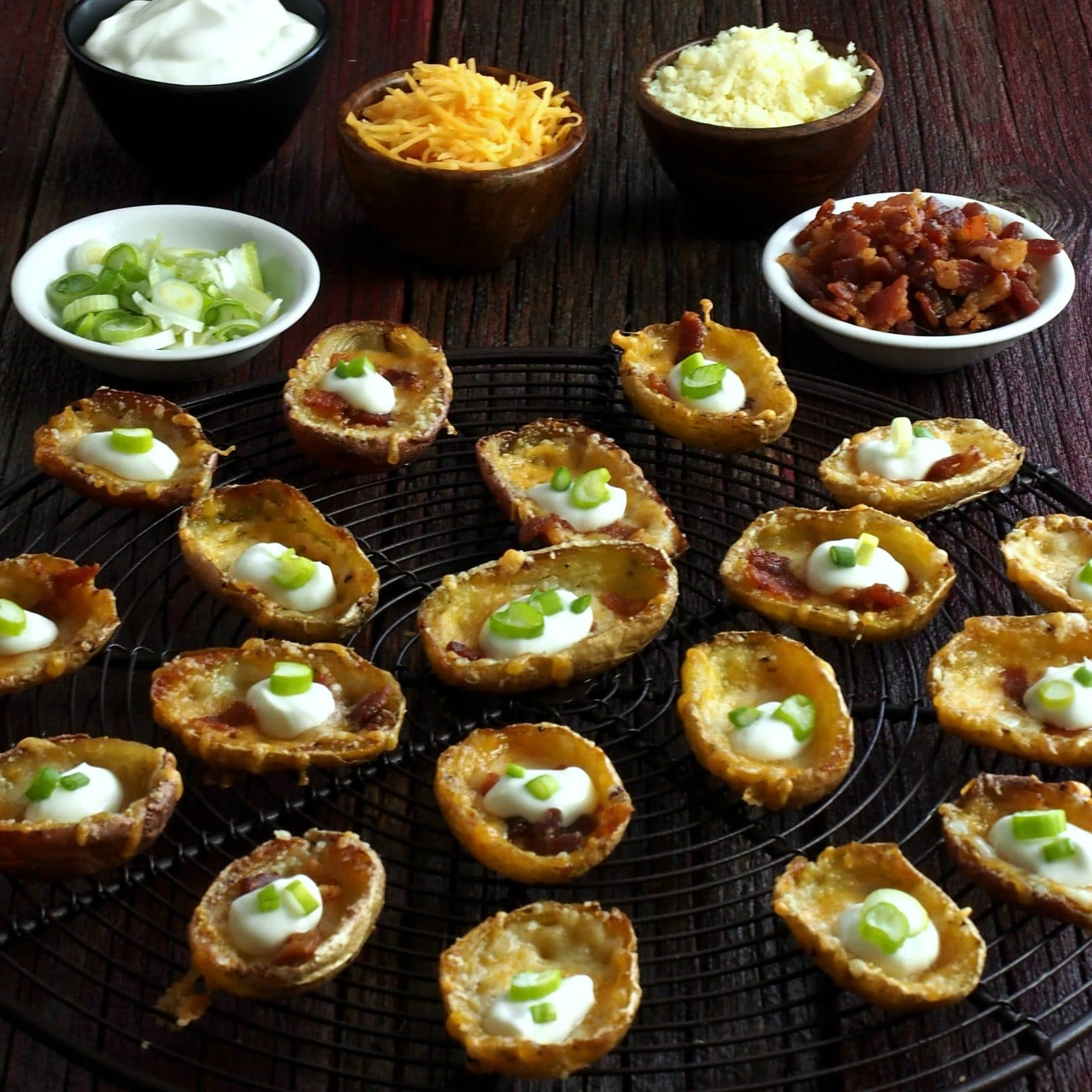 Three-Cheese Mini Potato Skins. The perfect bite-size appetizers. Mini potato skins loaded with three cheeses, bacon, sour cream and green onions. simply sated