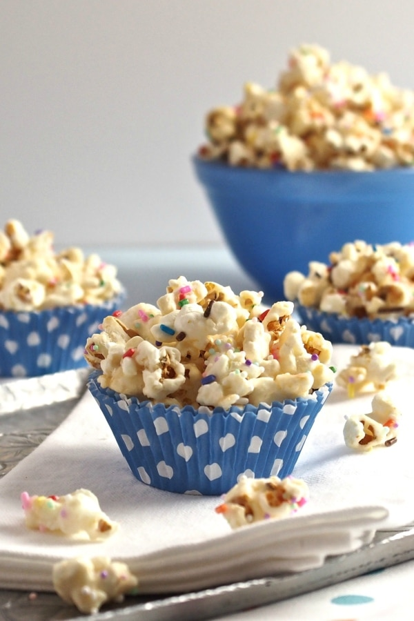 Birthday Popcorn is all dressed up just waiting to party. Kettle Corn, melting wafers, sprinkles & salt. An easy & fun treat for any celebration. Simply Sated