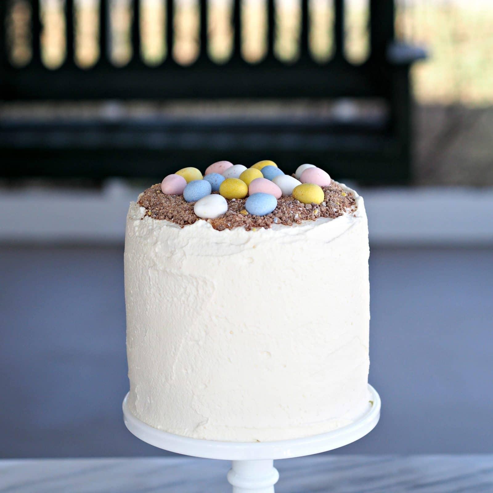 Cadbury Mini Eggs Cake with Mascarpone Whipped Cream. Layers of white cake married with Mascarpone Whipped Cream Frosting mixed w/crushed Cadbury Mini Eggs. Simply Sated