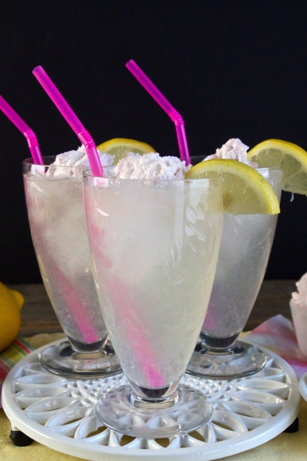 Homemade Lemonade with Raspberry Cream. Fresh squeezed lemonade swirled with Raspberry Mascarpone Cream. So heavenly, it must have been created by angels. Simply Sated