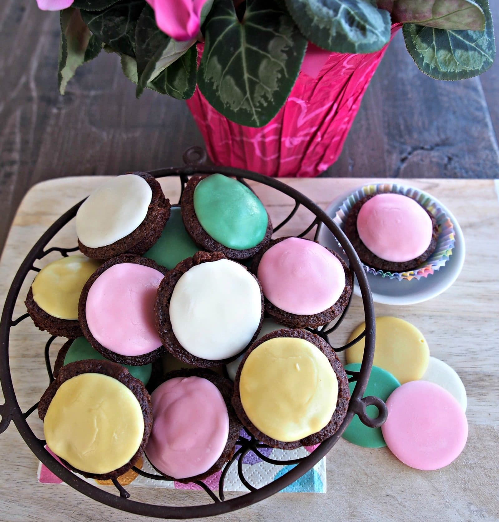 Pastel Mint Brownies are easy, lovely and delicious, and I dare you to eat just one. Brownie mix brownies topped warm with Lammes Candies Sherbet Mints. Simply Sated