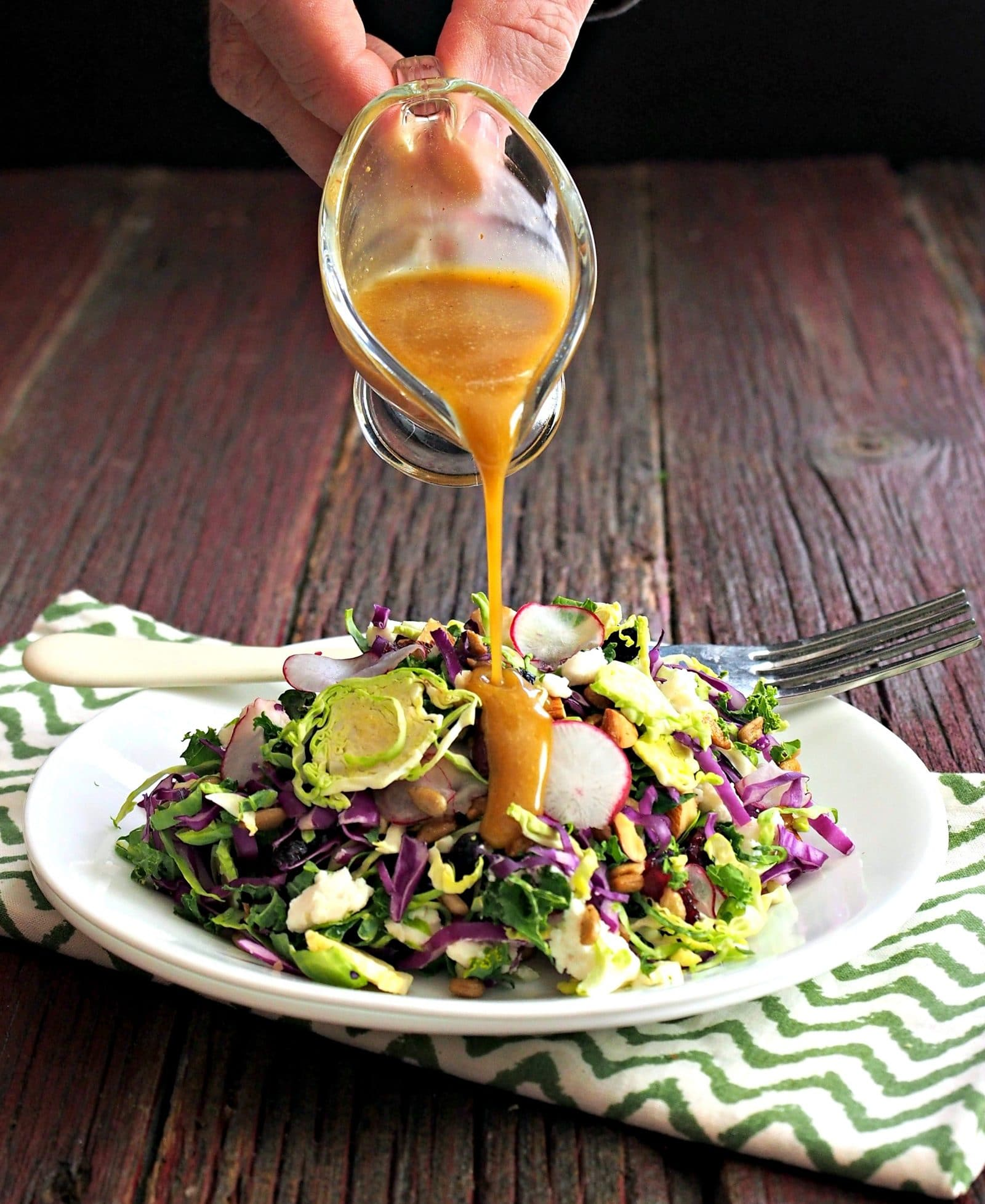 Power Salad with Spicy Honey Vinaigrette is packed with flavor & nutrients. Kale, broccoli, almonds, & others then drizzled with Spicy Honey Vinaigrette. Simply Sated