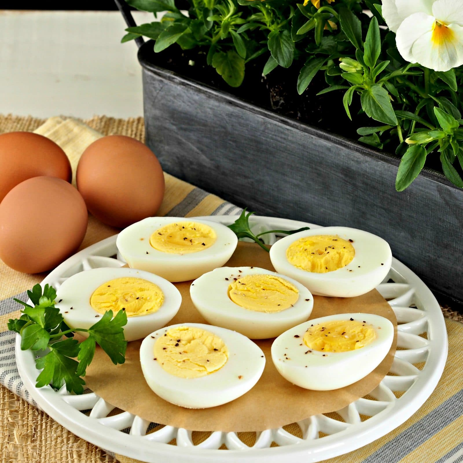 Hard-Cooked Steamed Eggs. Steaming eggs instead of boiling them creates eggs with yellow yolks, perfect whites & eggs easier to peel. Egg perfection. Simply Sated
