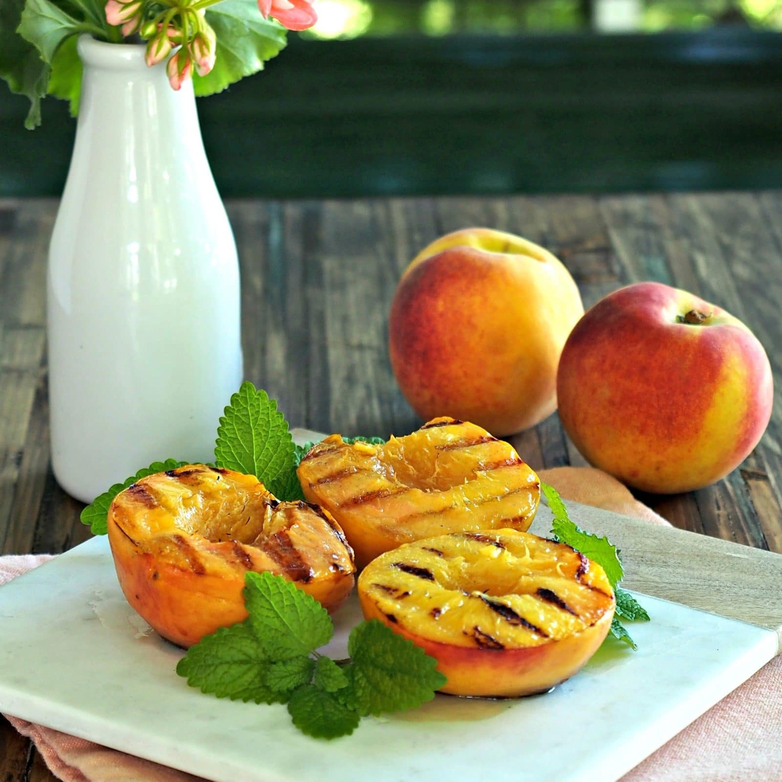 Watch Grilled Peaches and Angel Food Cake With Red-Wine Sauce video