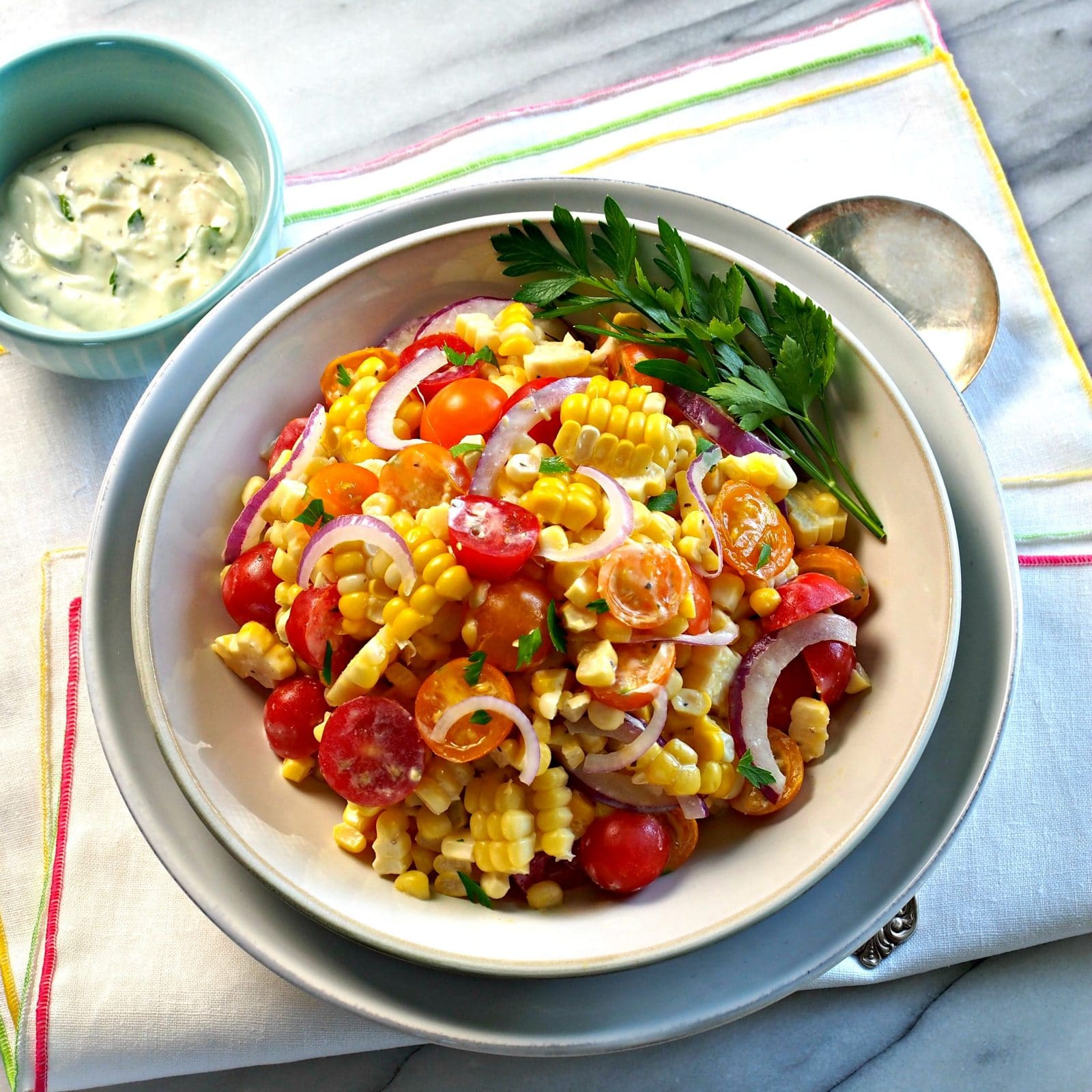 Market Fresh Corn Salad. The BEST of corn salads use the freshest ingredients: corn straight off the cob & summer tomatoes. Summer captured in a bowl. Simply Sated