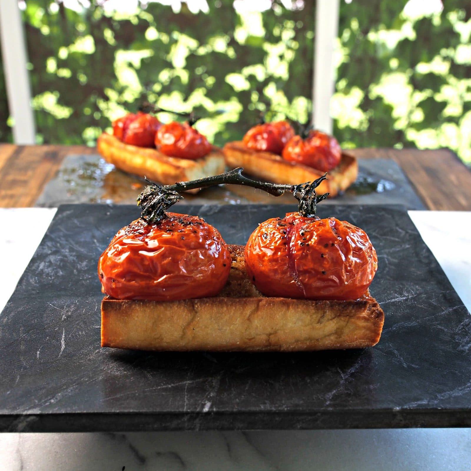 Roasted Tomato Bruschetta. Toasted Italian bread topped w/roasted tomatoes on the vine - the perfect appetizer for your favorite Italian meal. Simply Sated