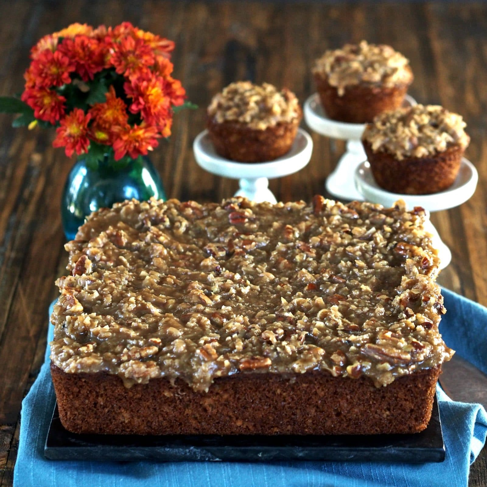 Old-Fashioned Oatmeal Cake & Cupcakes with Coconut Pecan Frosting. Moist, fall-spiced cake packed with flavor & topped, while warm, with perfect frosting. Simply Sated