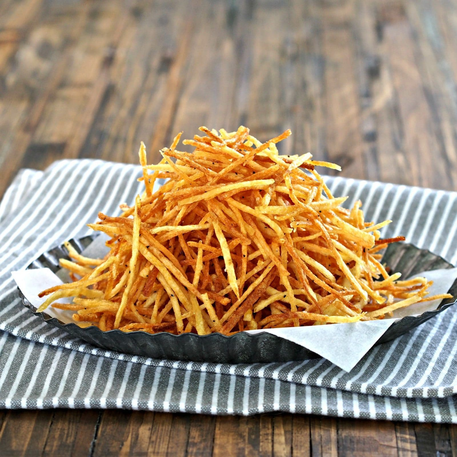 Crispy Crunchy Shoestring Potatoes. Matchstick potatoes deep-fried until golden brown then perfectly seasoned. Simple, delicious and addicting. Simply Sated