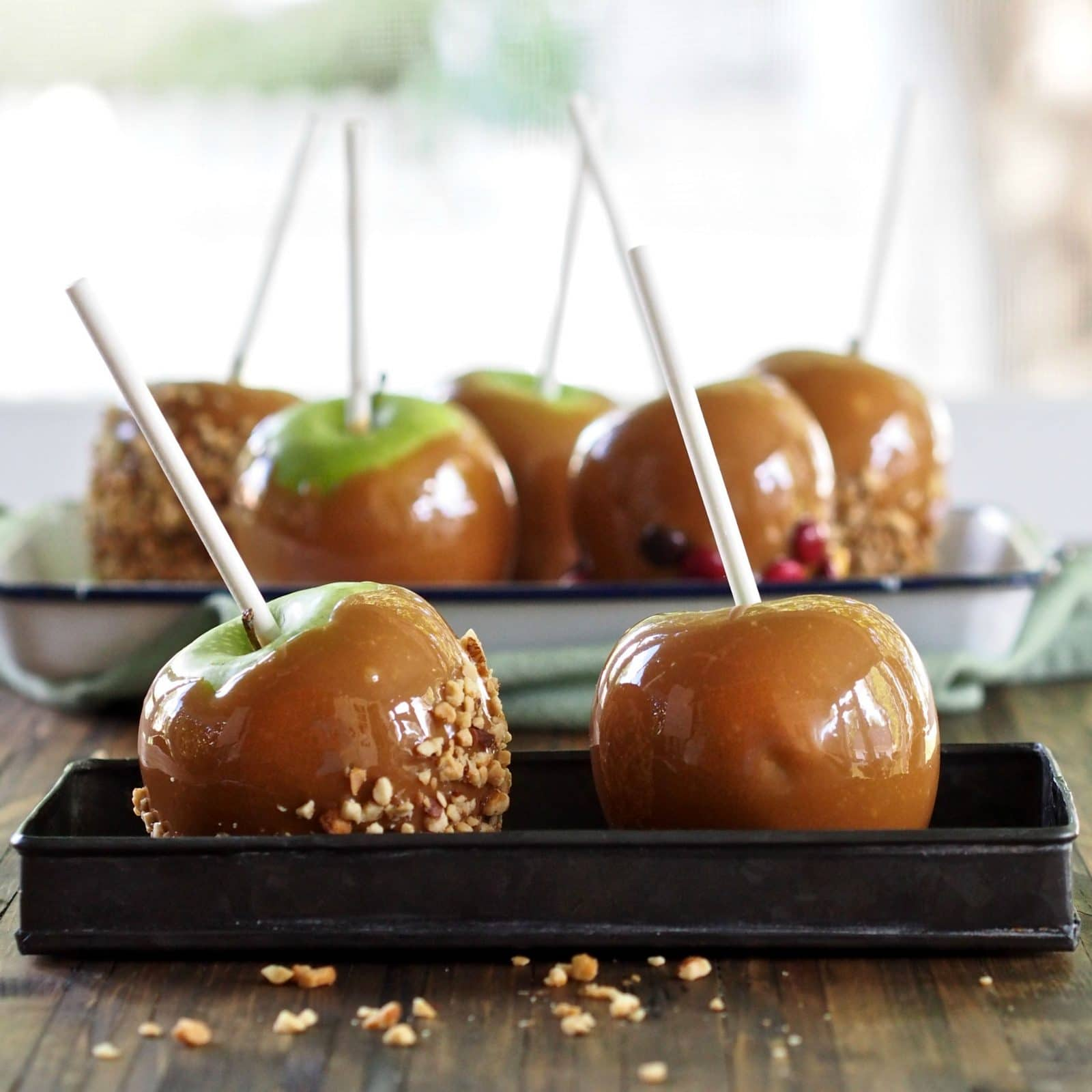 Classic Caramel Apples. Young or old - everyone's most-loved fall treat. Juicy, tart apples smothered in melted caramel then dipped in favorite toppings. Simply Sated