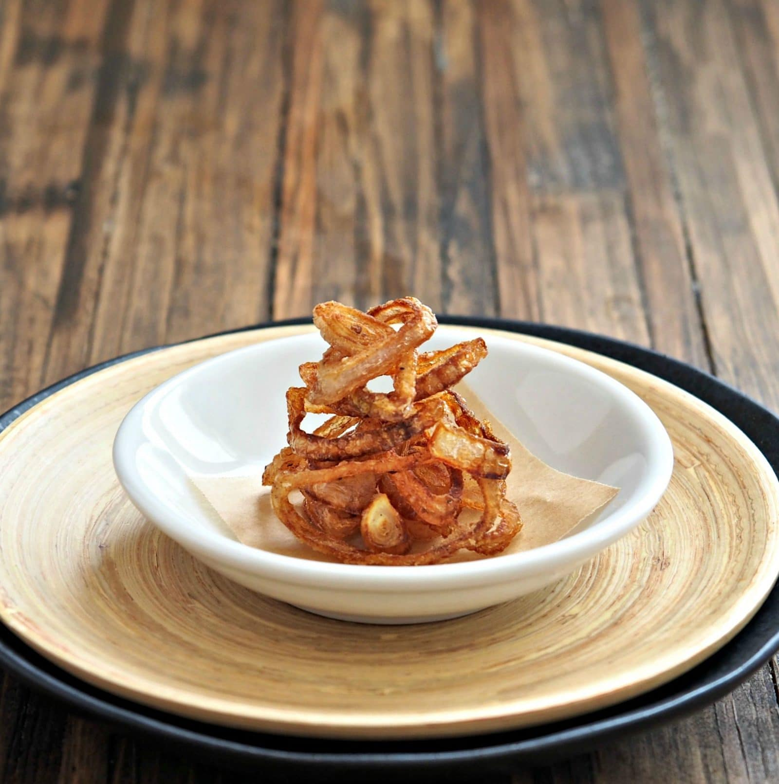 Crispy Shallots. Use Crispy Shallots to add flavor & texture to many of your favorite foods: sandwiches, steak, roast beef, chicken, eggs (to name a few). Simply Sated