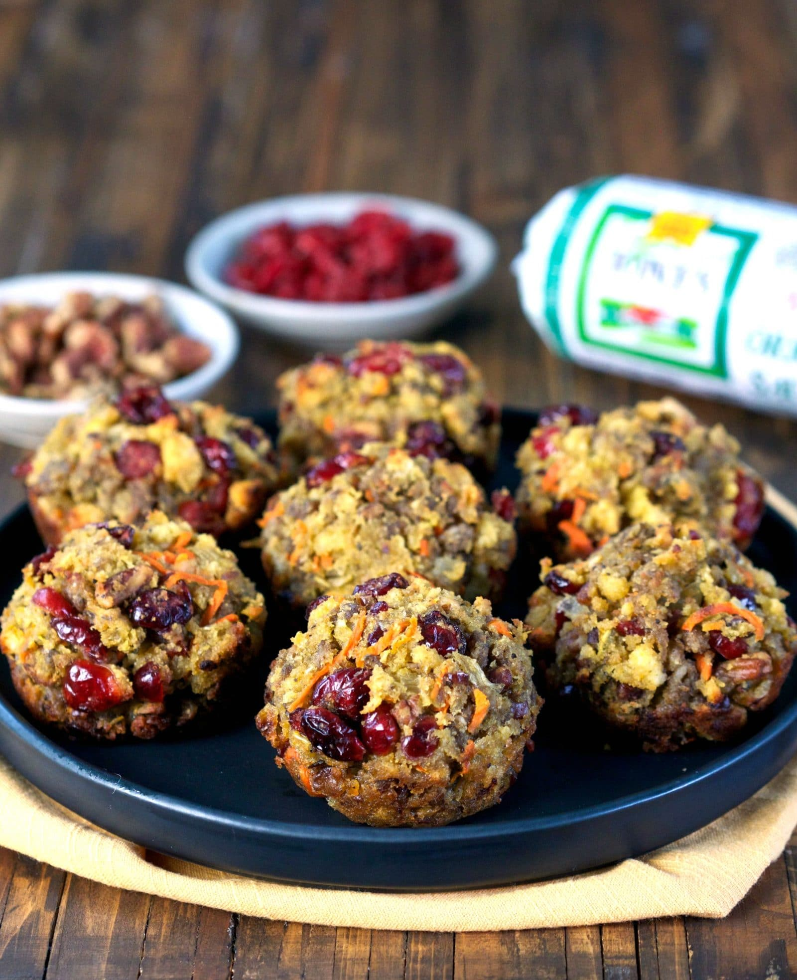 Sausage Cornbread Stuffing Muffins. Cornbread stuffing mixed with sausage, dried cranberries, shredded carrots & toasted pecans & baked in muffin tins. Simply Sated