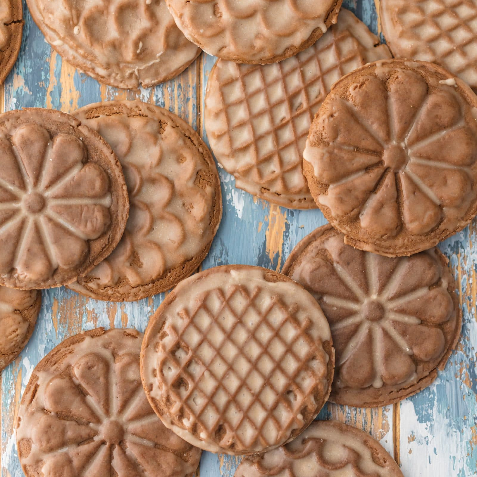 Rum-Glazed Soft Gingerbread Cookies have ideal texture and the warmth of molasses, ginger, cinnamon, cloves, cocoa & black pepper. The perfect gingerbread. Simply Sated