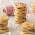 Cranberry Orange Almond Shortbread Cookies. Cranberries, oange zest, honey almonds all rolled up in an easy shortbread cookie dough. A perfect sweet treat. Simply Sated