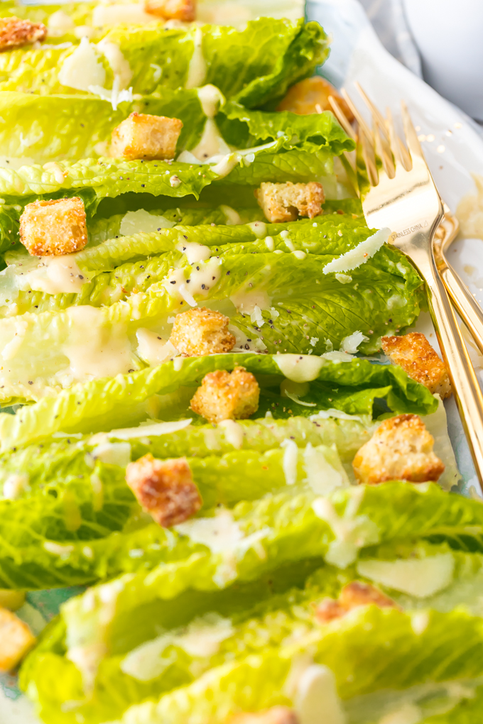 Classic Caesar Salad - there is so much to love. Crispy and leafy romaine lettuce, freshly shredded Parmigiano-Reggiano cheese & freshly ground black pepper, Homemade Garlic Parmesan Croutons drizzled with a creamy, umami-flavored dressing. This is the ultimate Classic Caesar Salad. Simply Sated