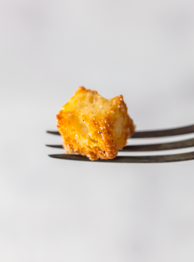 If you want homemade croutons in your life (and you do), Homemade Garlic Parmesan Croutons are THE choice. They are crispy, yet tender, with a hint of garlic and the perfect amount of Parmesan. They aren't only great on salad, they make a terrific snack. Simply Sated