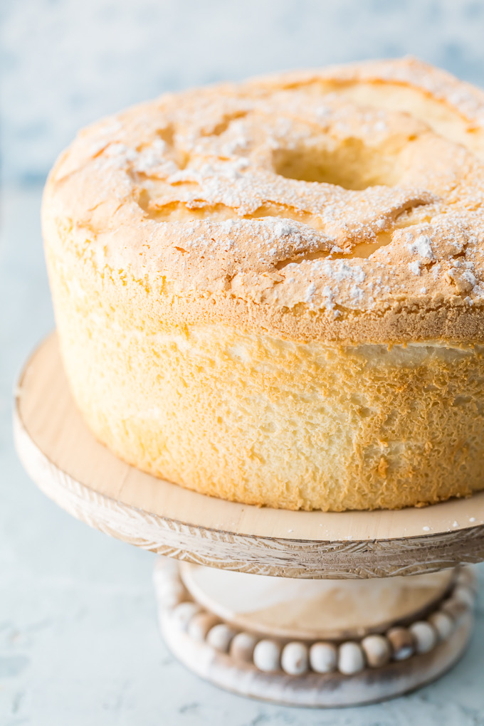 Game-Changing Angel Food Cake is truly game-changing. It is no-fuss and has a velvety, melt-in-your-mouth texture with a slightly crunchy top. It is just as delicious served with or without any toppings. This cake is the only Angel Food Cake one will ever need and is the best Angel Food Cake recipe - ever! Simply Sated