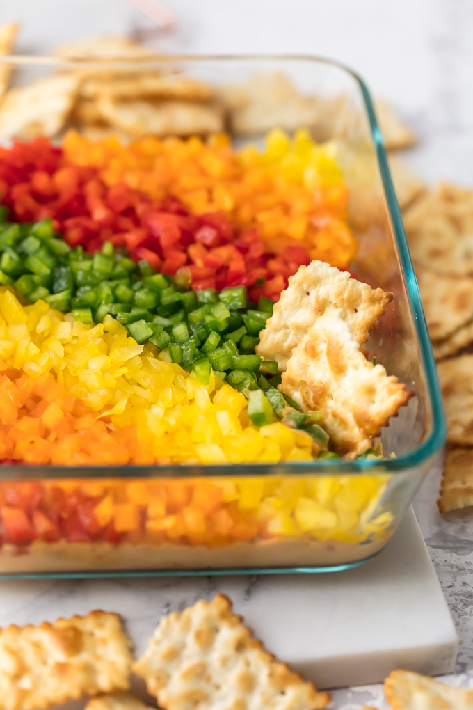 Rainbow Pepper Hummus Dip is tasty and gorgeous. It's also described with a 7-letter word...HEALTHY! It's a dip veggie-lovers love! It's a dip veggie-haters love! It's a dip children love, and it's a dip that will make you adored by the masses. So, join the Rainbow Pepper Hummus Dip party and you will be loved by all. Simply Sated
